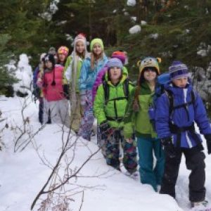 Group of Girls Hiking in Snow