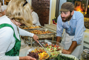"Community-style ""Farm Night"" dinners are held Wednesday evenings at the Wilburton Inn. Here, Oliver Levis explains the origin of salad ingredients."