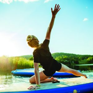girl doing yoga on standup paddleboard