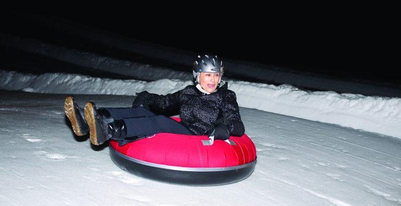 woman tubing on snow