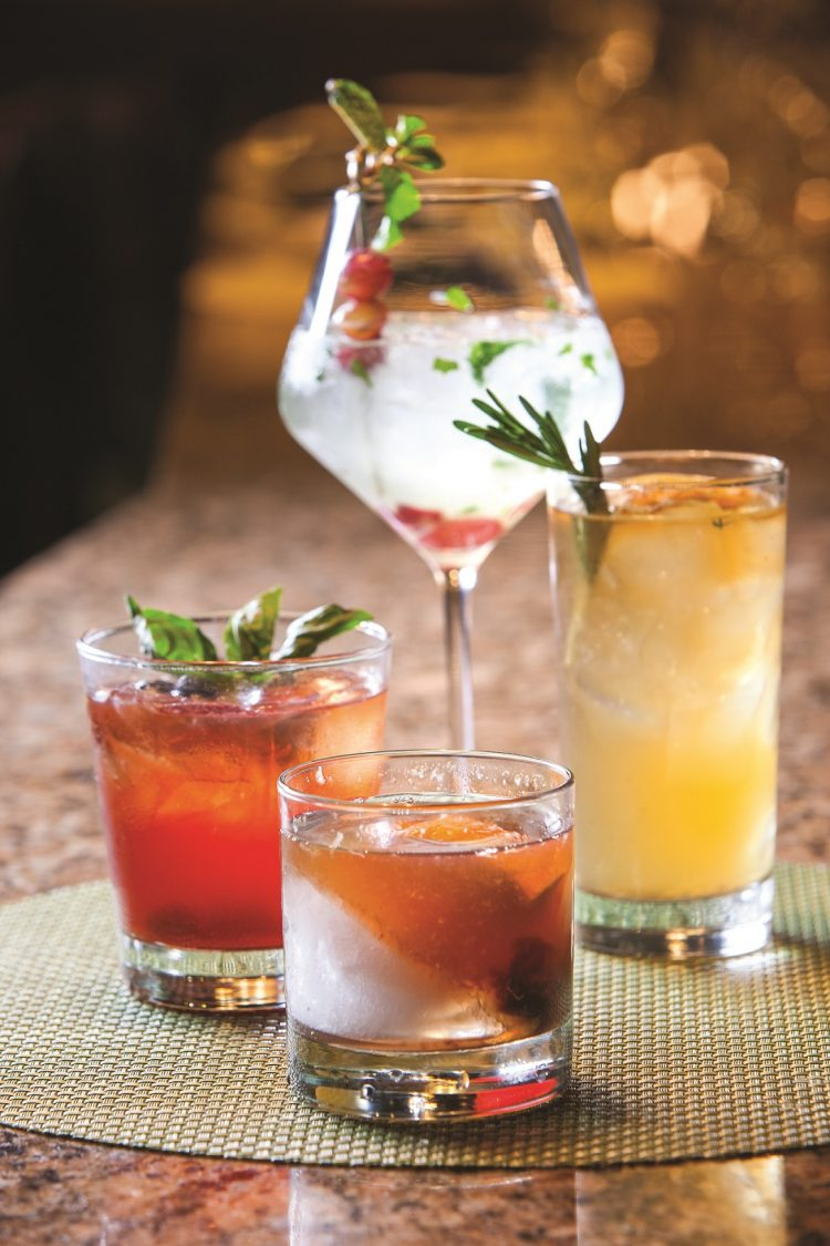 cocktails with herb garnishes
