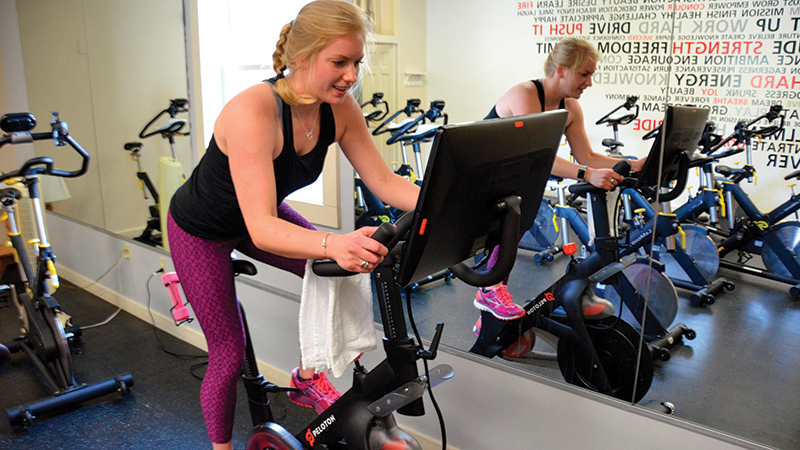 woman on spin bike stratton mountain fitness center
